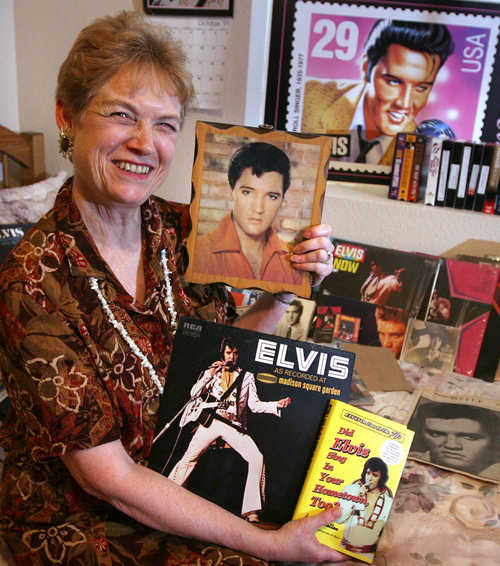 Barbara Taylor with some of the Elvis music and books she has collected.